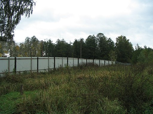 White wall and electric fence separating Russia and Lithuania