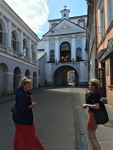 Mom and our English speaking tour guide at the merchant entrance to Vilnius (Wilno, to the Polish majority 100 years ago).
