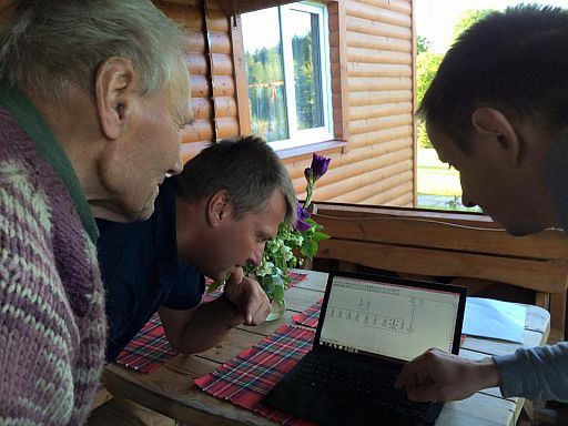 Henryk, Jonas, and our genealogist Zbyszek study the Jurkiewicz branch of the family tree belonging to my great grandfather, Michał.